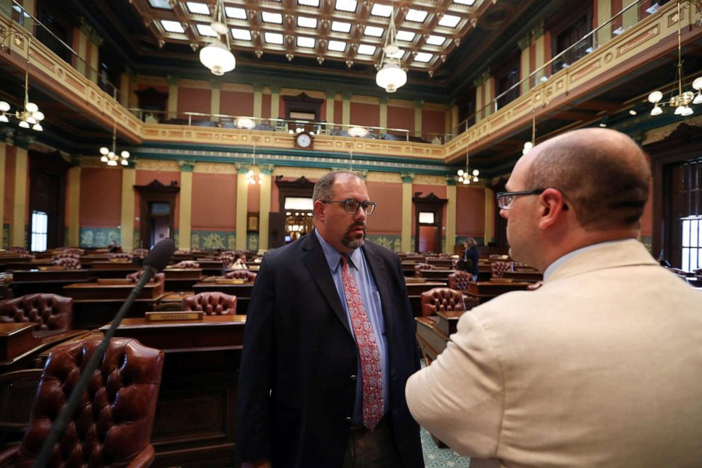 PHOTO: Michigan State Senator, Jim Ananich, Minority Leader, left, speaks on the floor of the Michigan state capital with state representative John Cherry, Aug. 27, 2019, in Lansing, Mich.