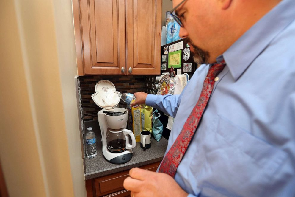 PHOTO: Michigan State senator Jim Ananich pours bottled water in his home coffee maker, Aug. 27, 2019, in Flint, Mich.
