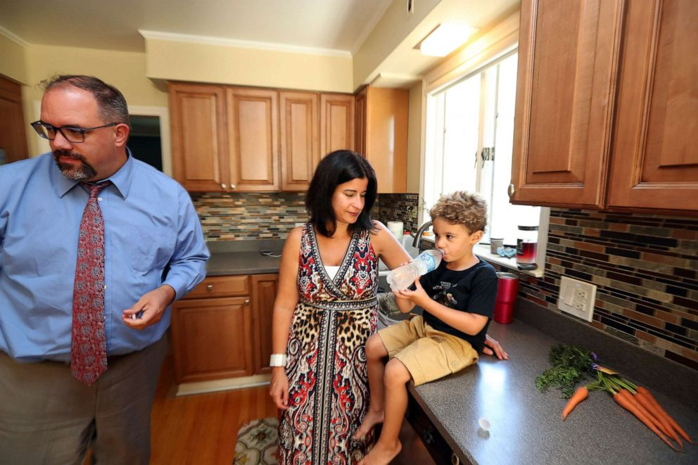 PHOTO: Michigan State senator Jim Ananich at home with his wife, Andrea Ananich and 4 year old son Jacob Ananich, Aug. 27, 2019, in Flint, Mich.