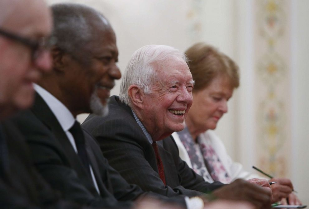 PHOTO: Former President Jimmy Carter, Kofi Annan, Gro Harlem Brundtland and other members of the Elders group attend a meeting with Russian President Vladimir Putin at the Novo-Ogaryovo residence, outside Moscow, on April 29, 2015.