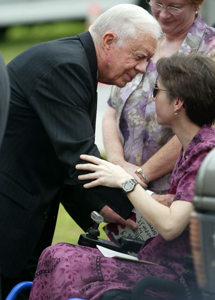 PHOTO: Former President Jimmy Carter comforts a bereaved Jeni Stepanek, mother of the late poet Mattie J.T. Stepanek, before his funeral at the St. Catherine Labour Catholic Church on June 8, 2004 in Wheaton, Md.