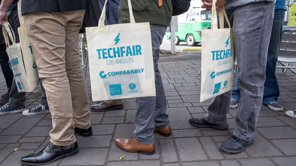 Job seekers line up at TechFair in Los Angeles, March 8, 2018.