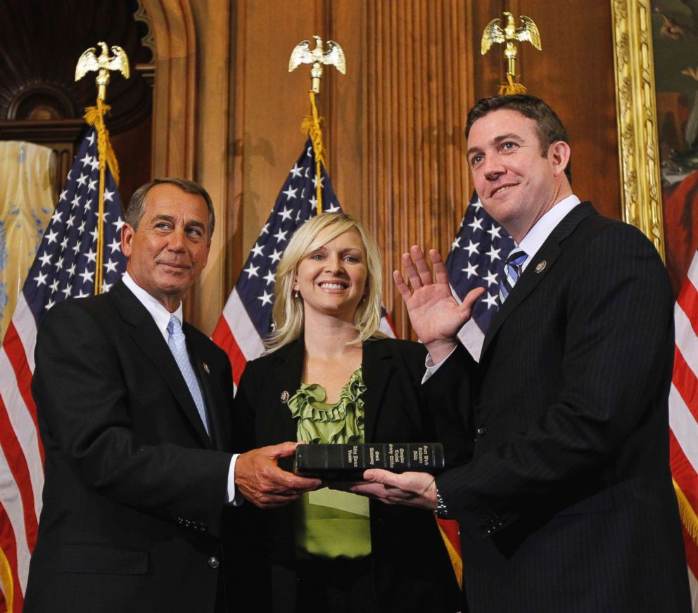 PHOTO: House Speaker John Boehner, left, administers the House oath to Rep. Duncan Hunter, as his wife, Margaret, looks on during a mock swearing-in ceremony on Capitol Hill in Washington, Jan. 5, 2011.
