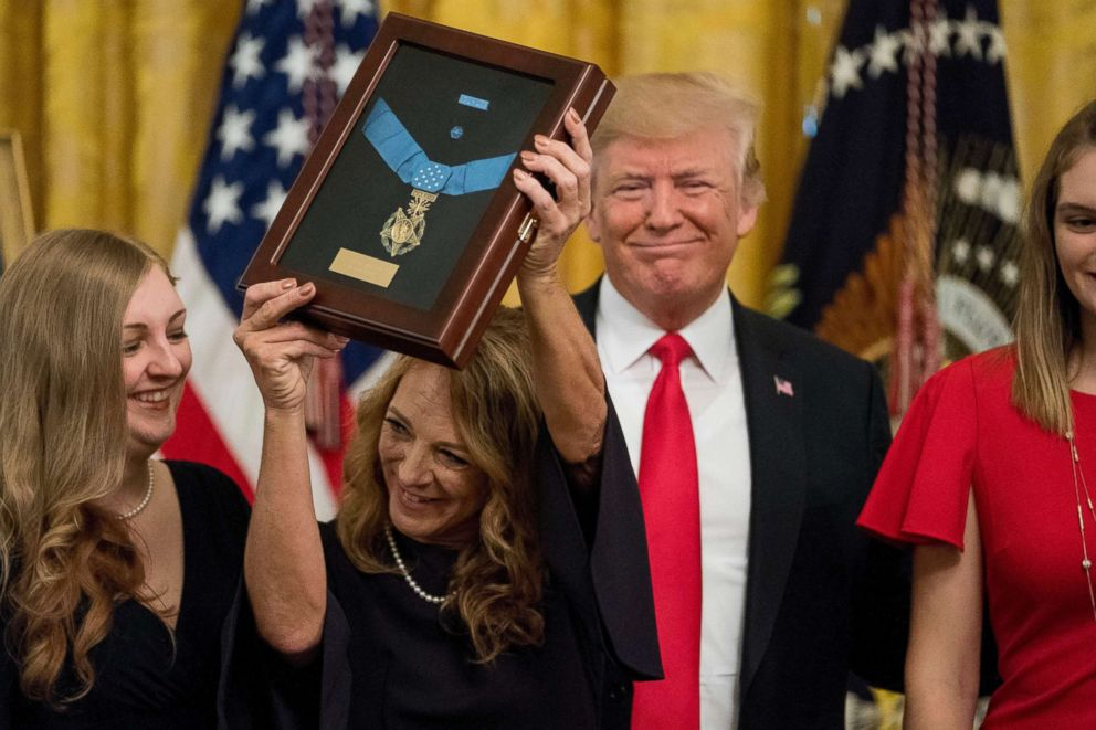 PHOTO: Valerie Nessel accepts the Medal of Honor from President Donald Trump for her husband Air Force Tech. Sgt. John A. Chapman, posthumously for conspicuous gallantry during a ceremony in the East Room of the White House, Aug. 22, 2018.