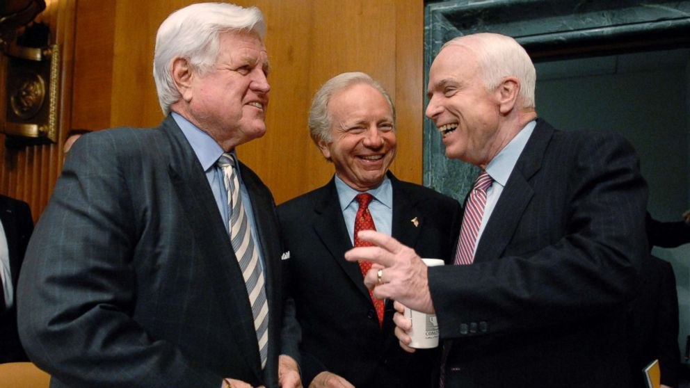 Senators Ted Kennedy, Joe Lieberman and John McCain speak to one another before the Senate Armed Services Committee hearing the war in Iraq on Capitol Hill in Washington, April 8, 2008.
