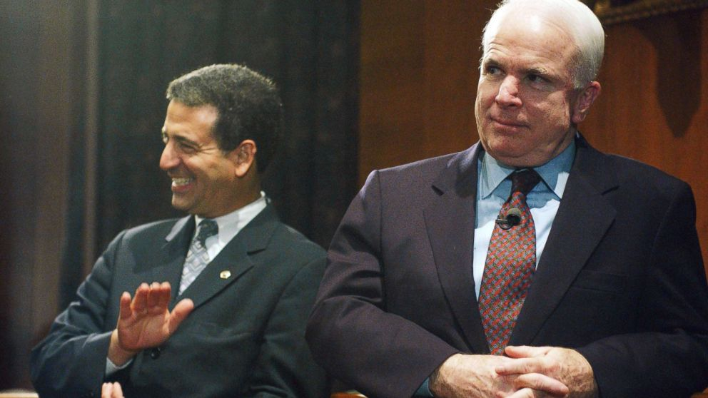 Sen. Russ Feingold and Sen. John McCain watch a rally in the Dirksen Senate Office Building after the cloture vote on the campaign finance reform bill on the Senate floor, March 20, 2002.