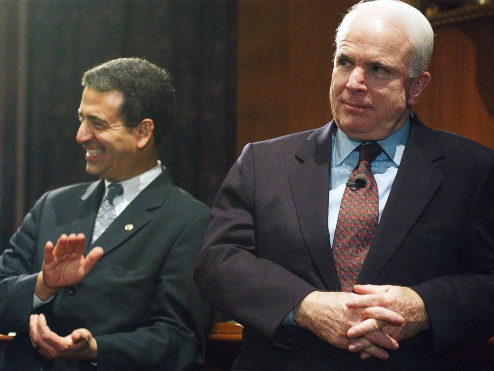 PHOTO: Sen. Russ Feingold and Sen. John McCain watch a rally in the Dirksen Senate Office Building after the cloture vote on the campaign finance reform bill on the Senate floor, March 20, 2002.