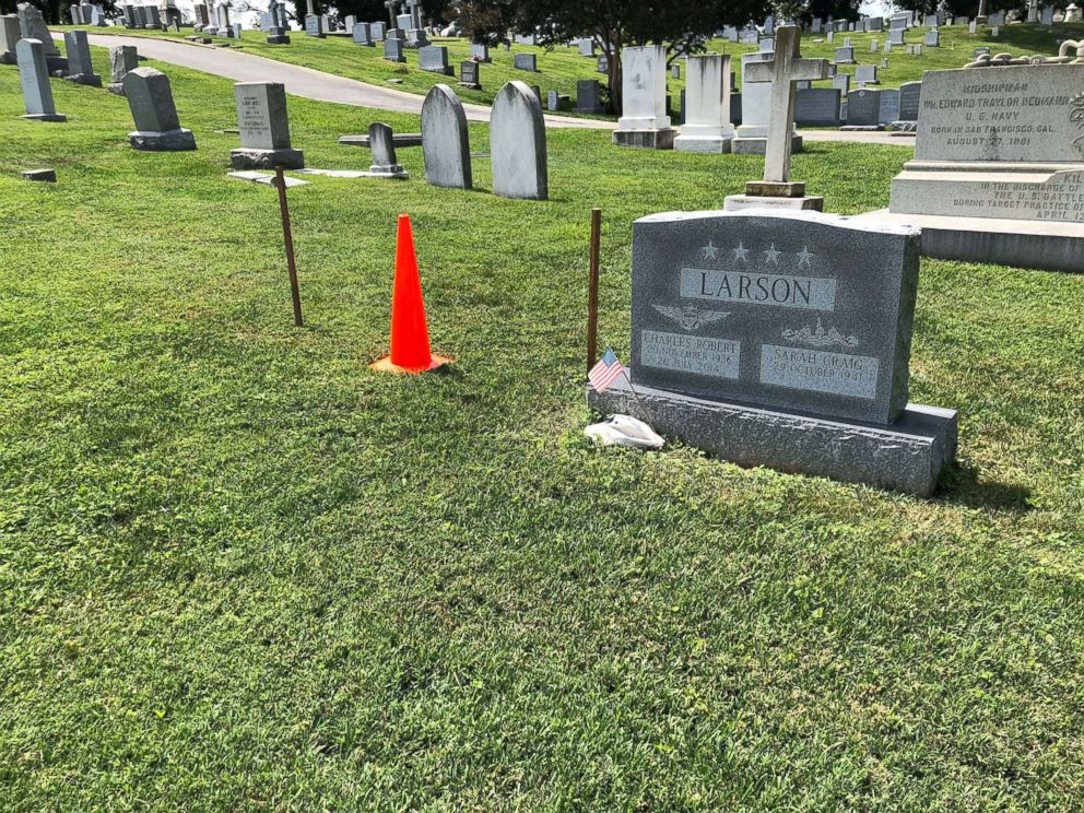 PHOTO: The burial plot of Sen. John McCain is marked with two wooden stakes and an orange cone at the U.S. Naval Academy Cemetery on Aug. 25, 2018, in Annapolis, Md.