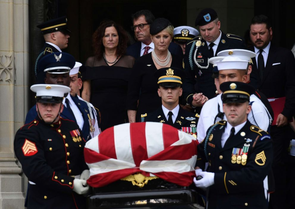 PHOTO: The casket of Sen. John McCain is carried out of the Washington National Cathedral in Washington, Sept. 1, 2018, after a memorial service, as Cindy McCain is escorted by her son Jimmy McCain and other family members.