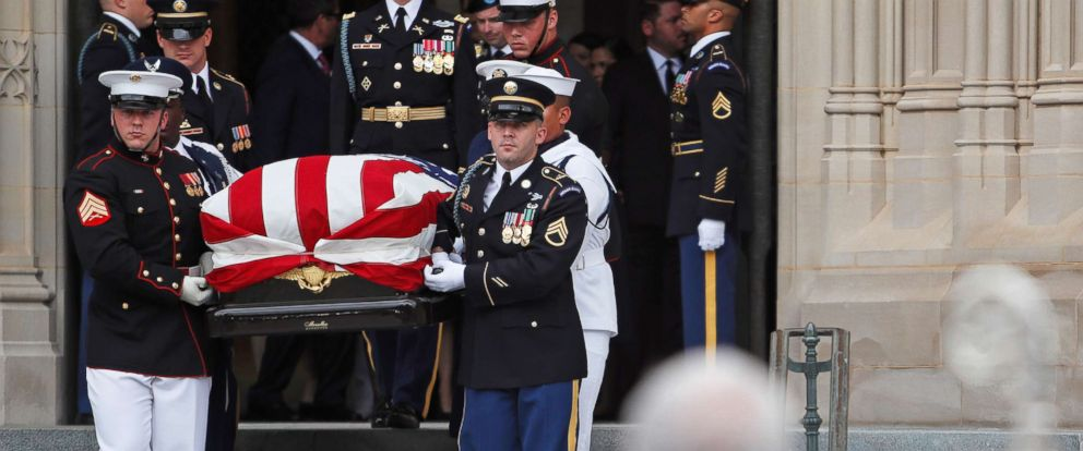 PHOTO: An Honor Guard carries the casket of the late Sen. John McCain from the Washington National Cathedral in Washington, D.C., Sept. 1, 2018.
