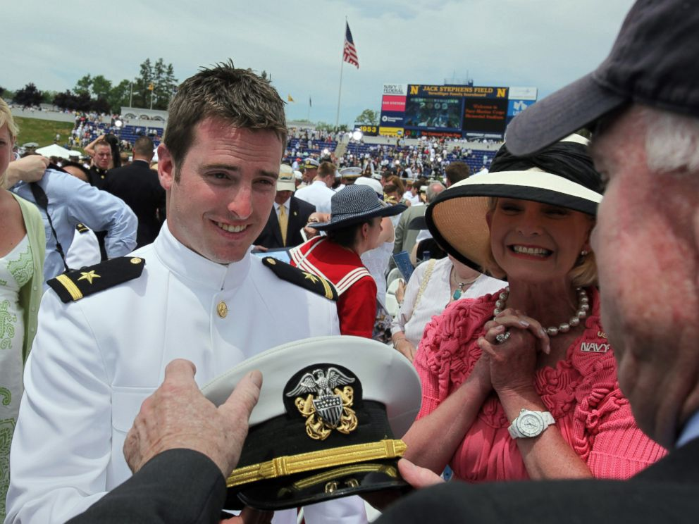 PHOTO: Jack McCain shows his cap to his parents, Sen. John McCain and Cindy McCain, at his commencement ceremony at the U.S. Naval Academy in Annapolis, Md., May 22, 2009.