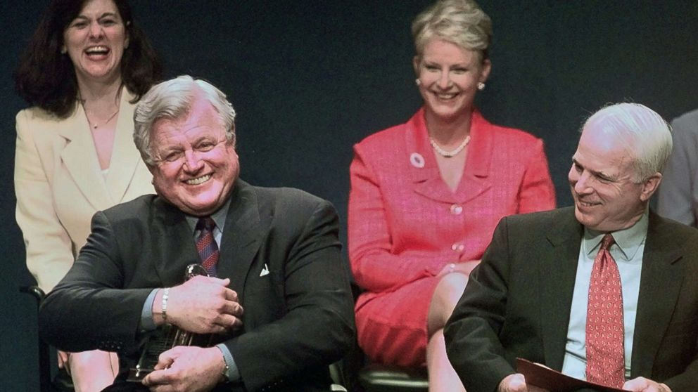 Sen. Ted Kennedy jokingly holds the Profile in Courage award as if he intends to keep it, as co-winner, Sen. John McCain, right, reacts during a ceremony at the John F. Kennedy Library in Boston, May 24, 1999.
