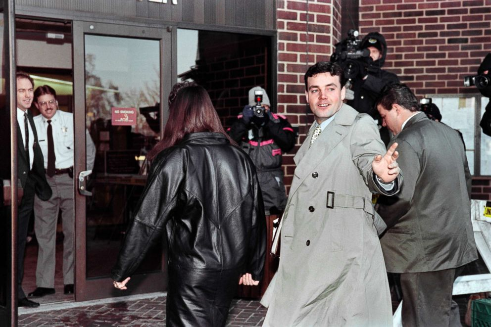 PHOTO: John Wayne Bobbitt points toward photographers as he arrives at the Prince William County Courthouse in Manassas on Jan. 18, 1994, for the fifth day of his wife Lorenas trial for malicious wounding.