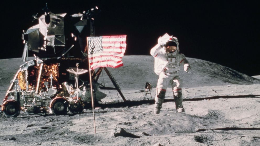 John W. Young, Commander of Apollo 16 moon mission, salutes the United States flag as he leaps from the lunar surface near the lunar lander in this undated file photo.