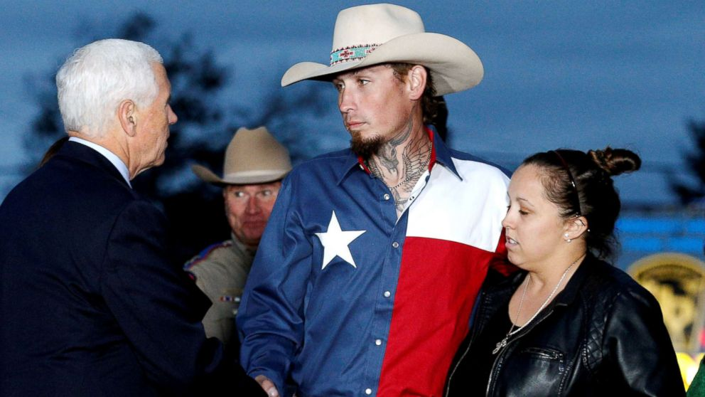 Vice President Mike Pence shakes hands with Johnnie Langendorff, who was one of the heroes that chased the assailant, near the site of the shooting at the First Baptist Church of Sutherland Springs in Sutherland Springs, Texas, Nov. 8, 2017.