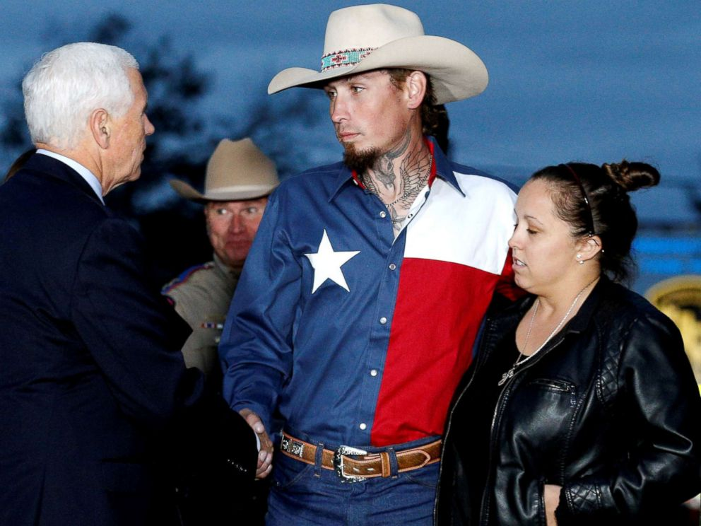 PHOTO: Vice President Mike Pence shakes hands with Johnnie Langendorff, who was one of the heroes that chased the assailant, near the site of the shooting at the First Baptist Church of Sutherland Springs in Sutherland Springs, Texas, Nov. 8, 2017.