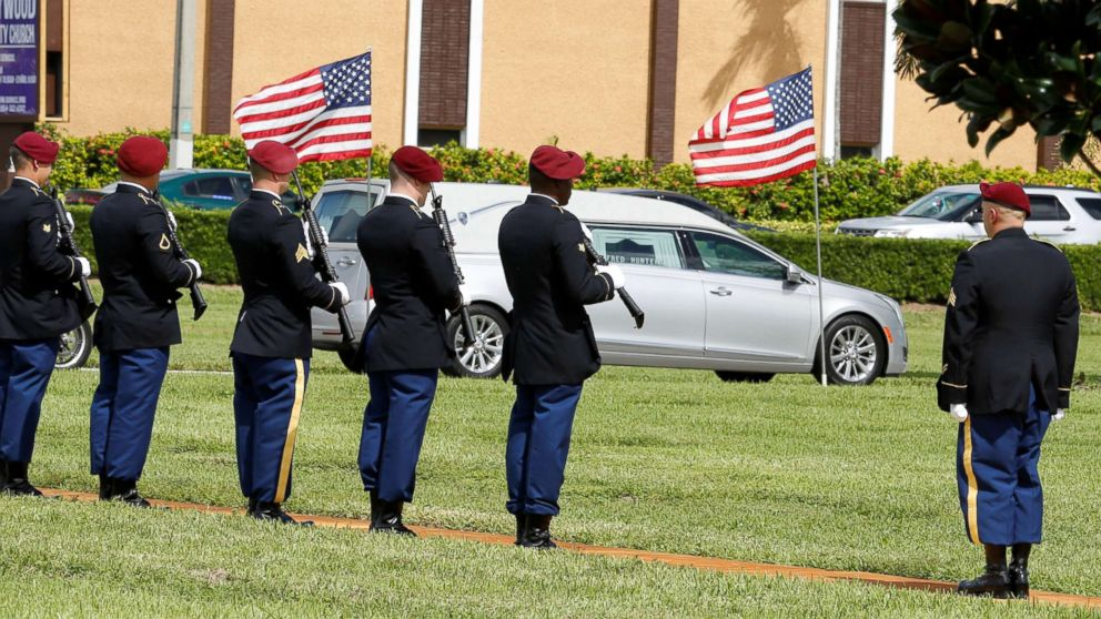 An honor guard stands at attention as a hearse carries the coffin of U.S. Army Sergeant La David Johnson, who was among four special forces soldiers killed in Niger, to a graveside service in Hollywood, Fla., Oct. 21, 2017.