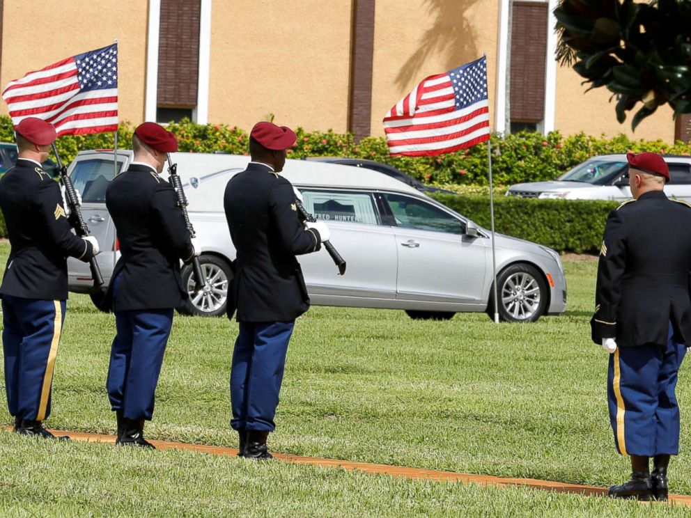 PHOTO: An honor guard stands at attention as a hearse carries the coffin of U.S. Army Sergeant La David Johnson, who was among four special forces soldiers killed in Niger, to a graveside service in Hollywood, Fla., Oct. 21, 2017.