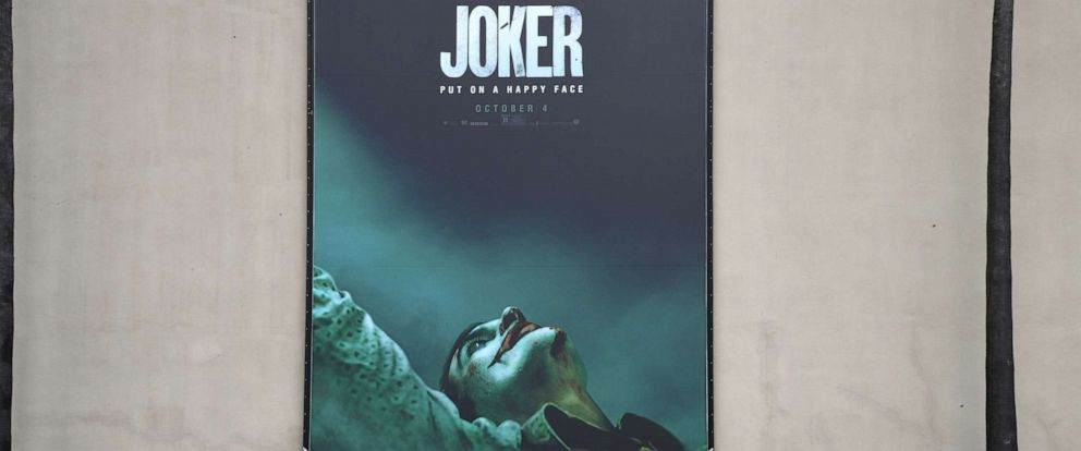 """PHOTO: A poster for the upcoming film """"The Joker"""" is seen outside Warner Brothers Studios in Burbank, Calif., Sept. 27, 2019."""