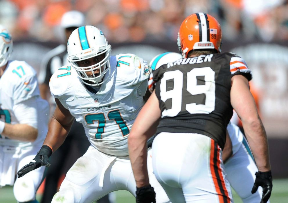 Martin #71 of the Miami Dolphins prepares to block linebacker Paul Kruger #99 of the Cleveland Browns