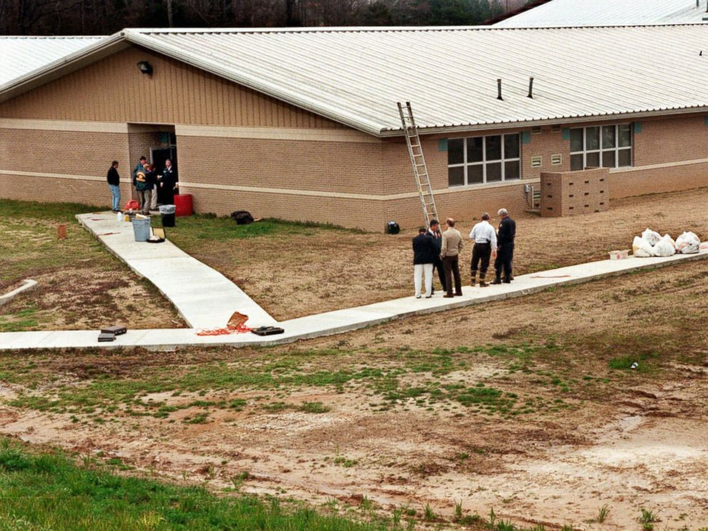 PHOTO: Officials examine the scene at Westside Middle School in Jonesboro, Ark., March 24, 1998, after two boys fired on teachers and students.