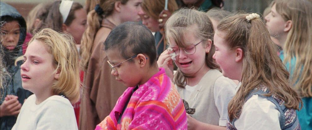 PHOTO: Grieving students from the Nettleton School District in Jonesboro, Ark., leave a moment of silence gathering, March 31, 1998,.