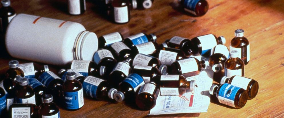 PHOTO: Bottles of poison belonging to members of the Peoples Temple cult, who participated in a mass suicide/murder by ingesting a cyanide-laced drink, are seen on a table in Jonestown, Guyana, 1978.