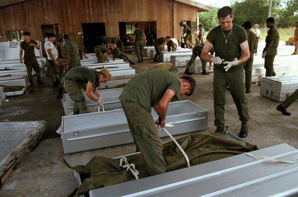 PHOTO: U.S. military personnel place bodies in coffins at the airport in Georgetown, Guyana, after over 900 members of the Peoples Temple committed suicide in Jonestown, Guyana in Nov. 1978.