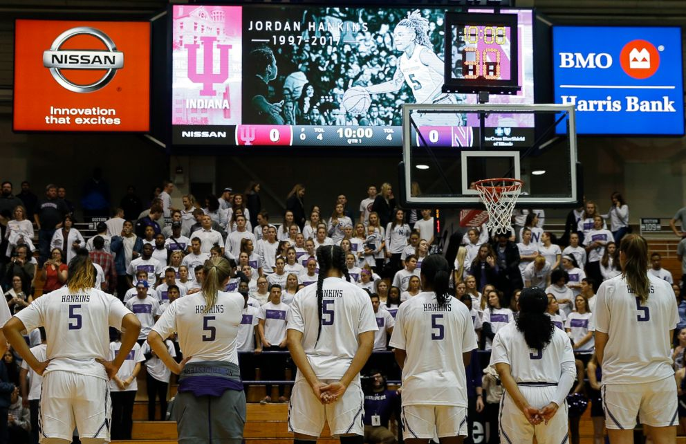 PHOTO: Northwestern University womens basketball players, all wearing the jersey number of teammate Jordan Hankins, bow their heads during a moment of silence at the Welsh Ryan Arena in Evanston, Ill., Jan. 14, 2017.