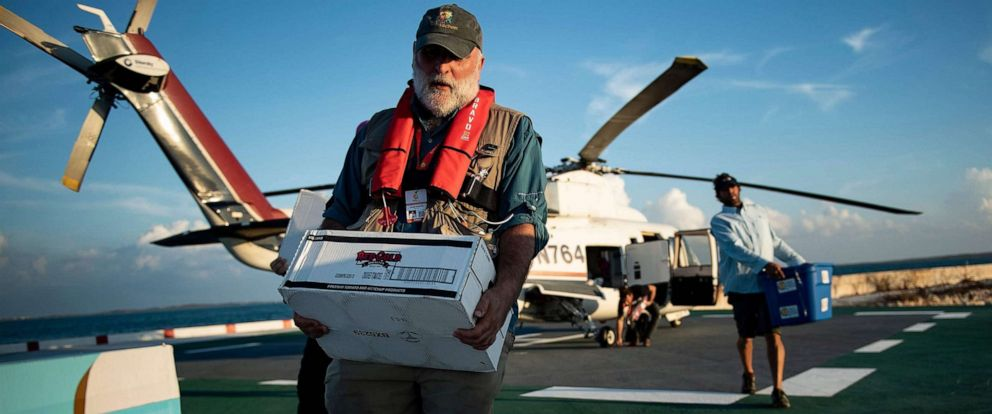 PHOTO: Chef Jose Andres carries food relief while working with his charity group World Central Kitchen to help survivors of Hurricane Dorian Sept. 5, 2019, in Marsh Harbor, Great Abaco, Bahamas.