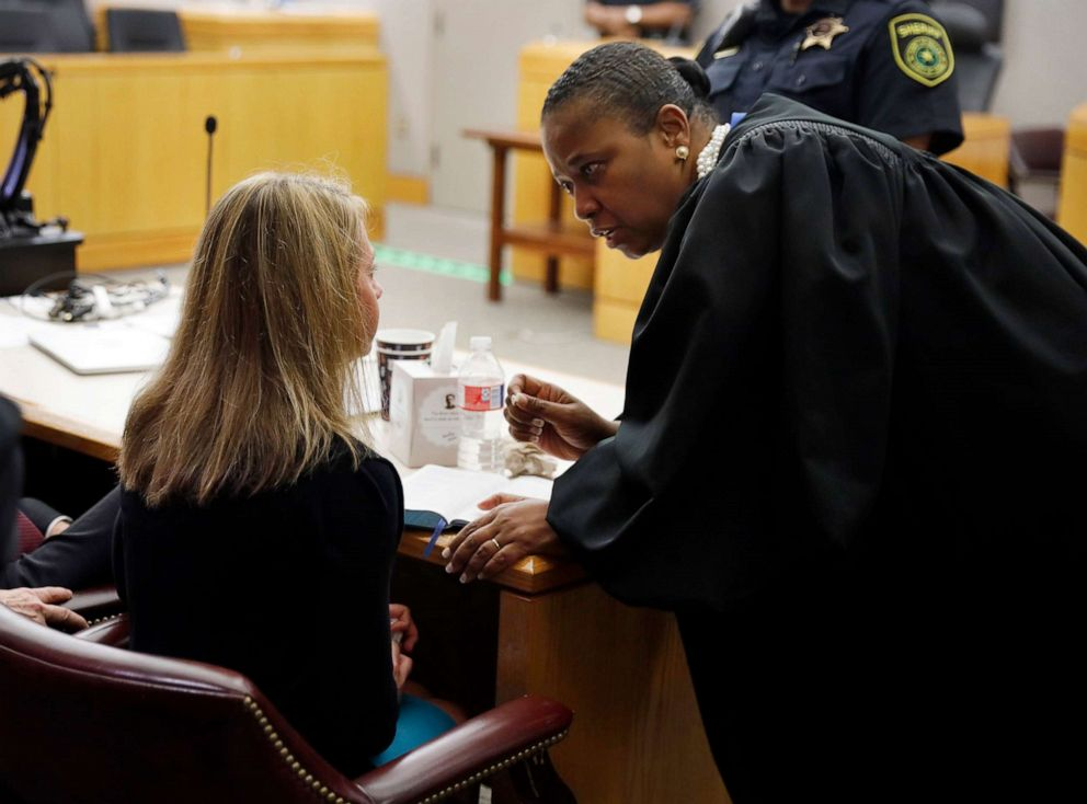 PHOTO: Former Dallas Police Officer Amber Guyger, left, listens to words of advice and encouragement from State District Judge Tammy Kemp after the judge had given her a Bible and before Guyger left for jail, Oct. 2, 2019, in Dallas.