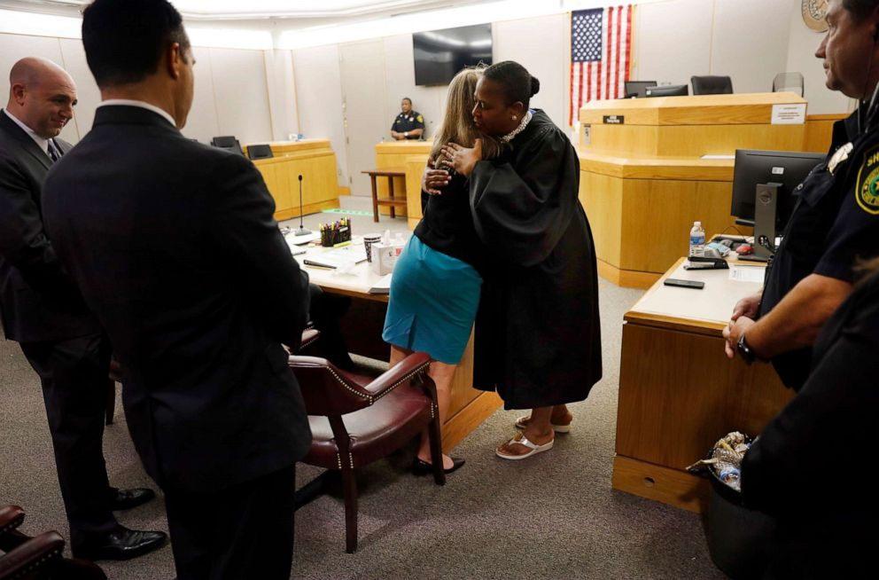 PHOTO: Former Dallas Police Officer Amber Guyger gives State District Judge Tammy Kemp a hug after the judge had given her a Bible and before Guyger left for jail, Oct. 2, 2019, in Dallas.