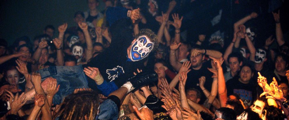 PHOTO: Insane Clown Posse crowd surfs over the audience of juggalos.