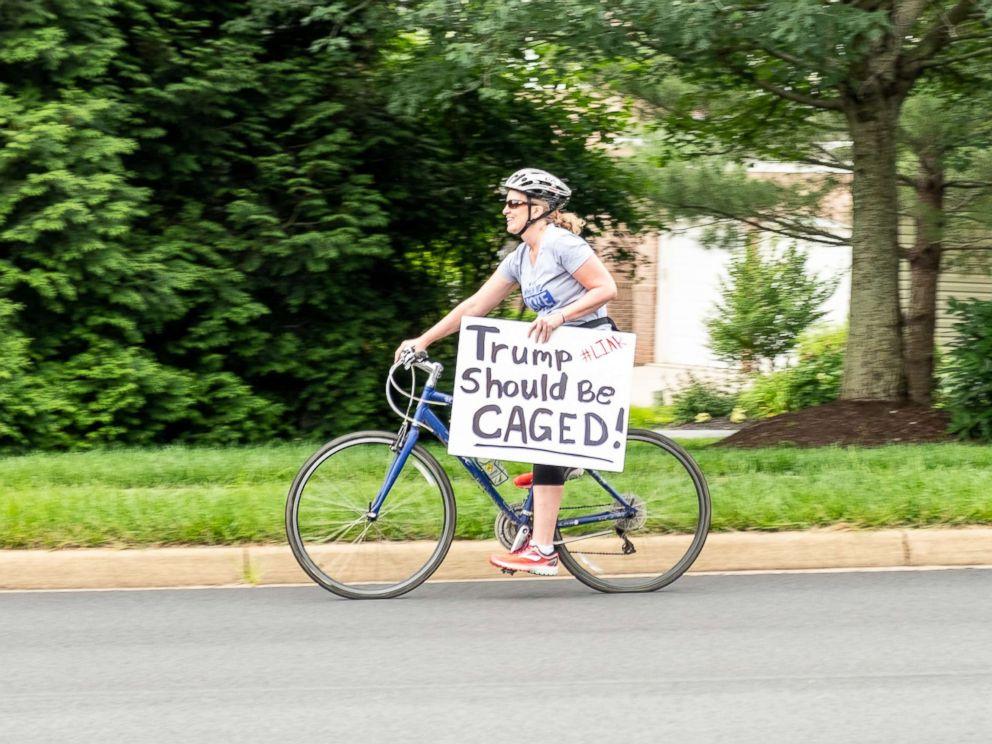 PHOTO: Juli Briskman participates in a protest against President Donald Trump in Sterling, Va., in June.