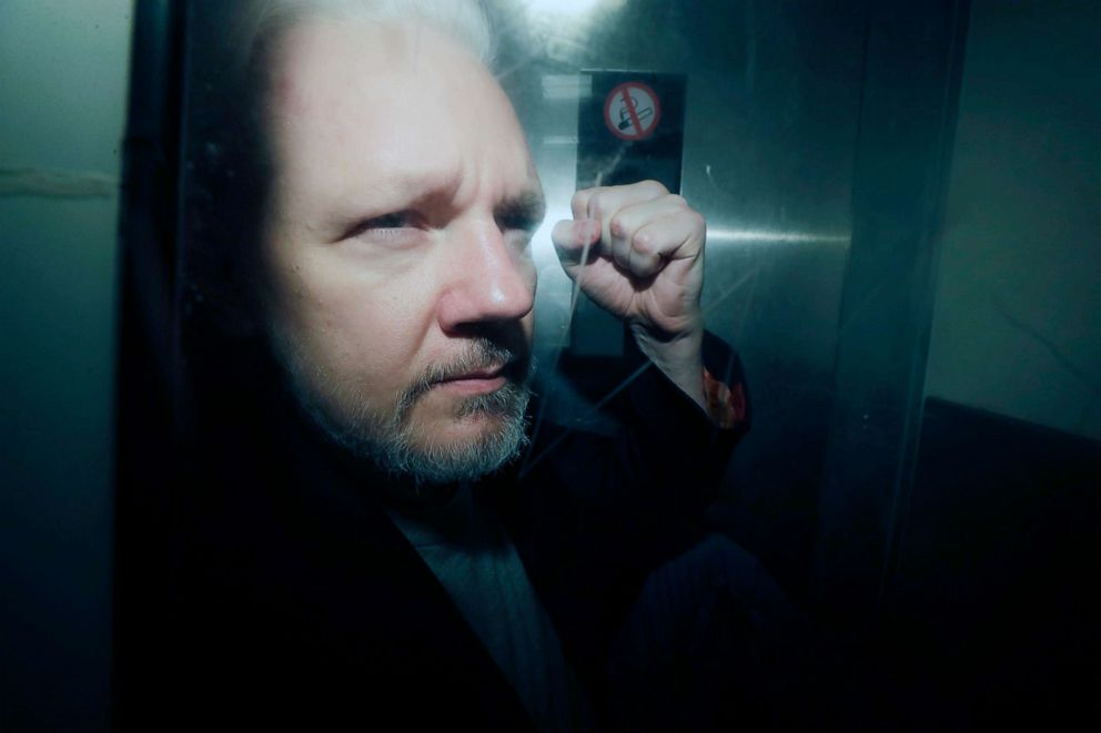 PHOTO: In this May 1, 2019, file photo, WikiLeaks founder Julian Assange puts his fist up as he is taken from court in London.