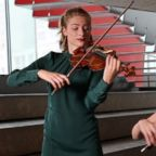Mariella Haubs and Jocelyn Zhu two Juilliard School alums travel the world playing at refugee camps.