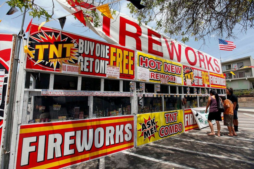 PHOTO: In this July 2, 2013, file photo, a family buys fireworks at a TNT Fireworks stand in Monterey Park, Calif.