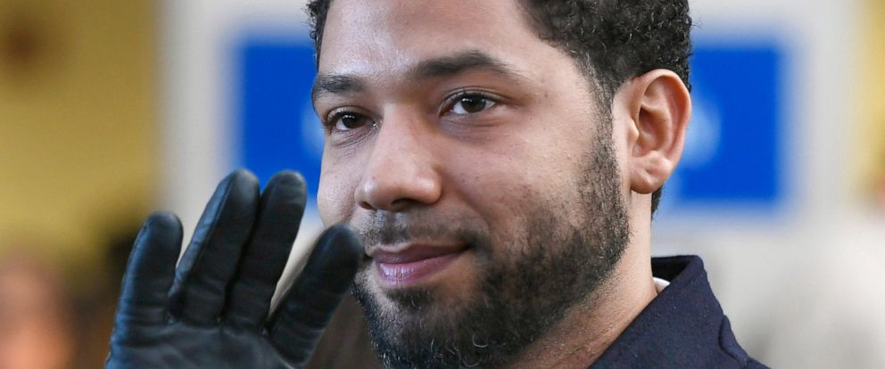 PHOTO: In this March 26, 2019, file photo, Actor Jussie Smollett smiles and waves to supporters before leaving Cook County Court after his charges were dropped in Chicago.