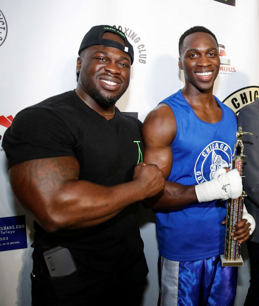 PHOTO: In this file photo. Abel Osundairo (L) celebrates with brother Olabinjo Osundairo (R) after defeating John Broderick in a Golden Gloves senior novice light heavyweight division final boxing match in Chicago on April 12, 2019.