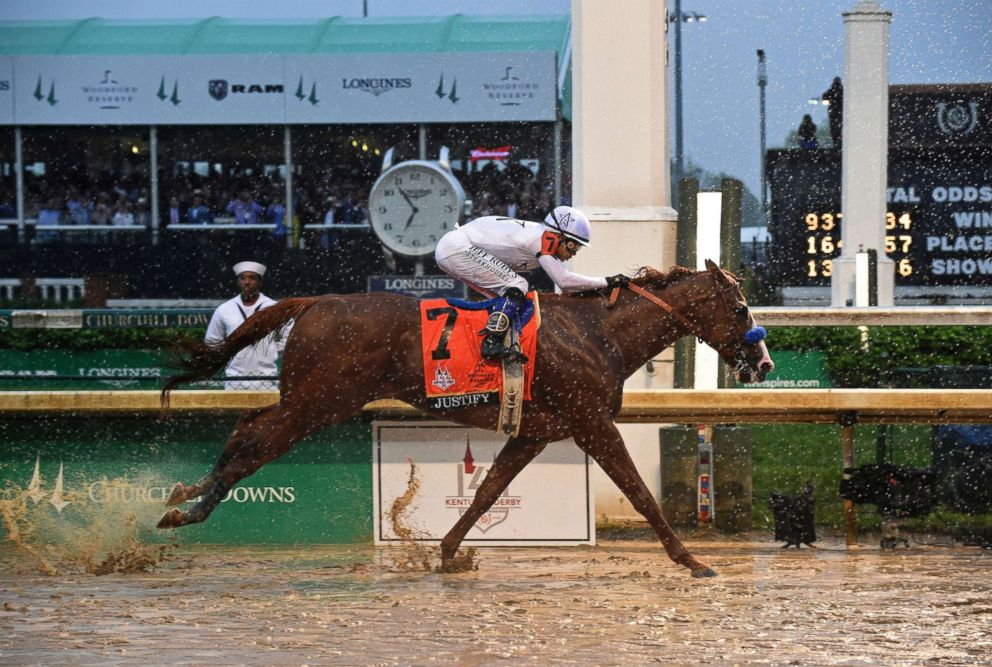 PHOTO: Justify, ridden by jockey Mike Smith, wins the 144th Kentucky Derby, May 5, 2018, at Churchill Downs in Louisville, Ky.