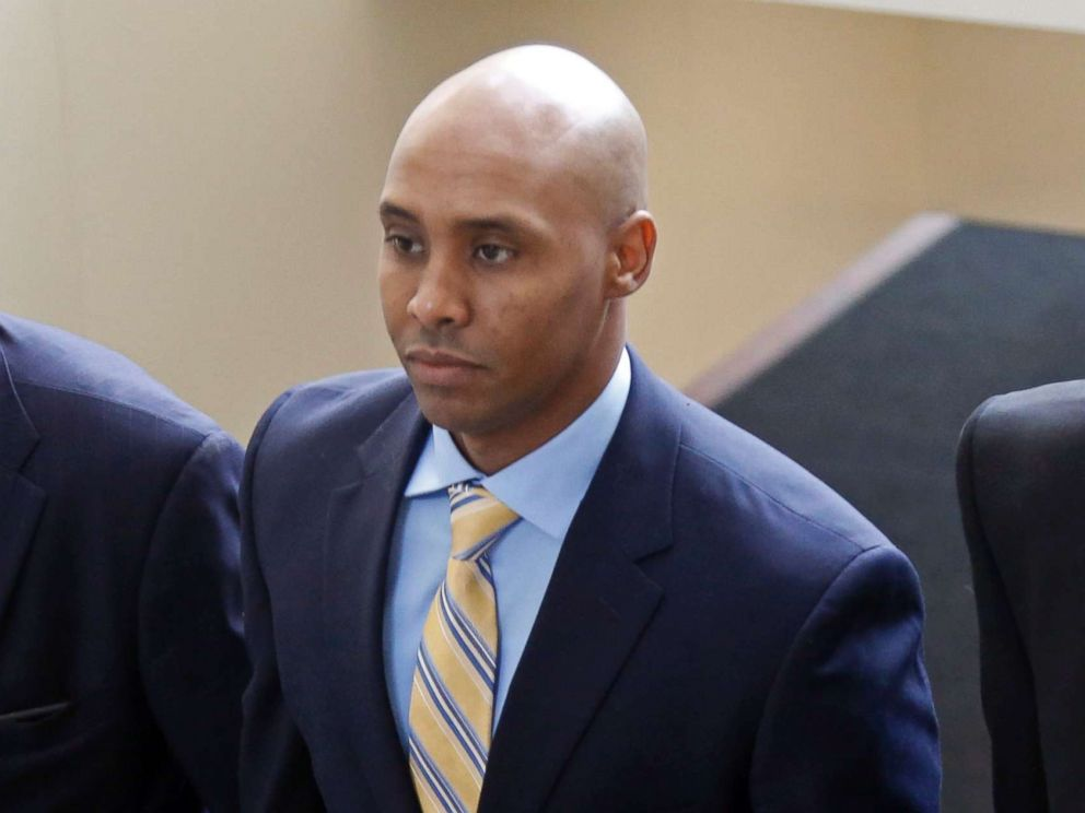 PHOTO: Mohamed Noor arrives with his legal team at the Hennepin County Government Center for a hearing, May 8, 2018, in Minneapolis.