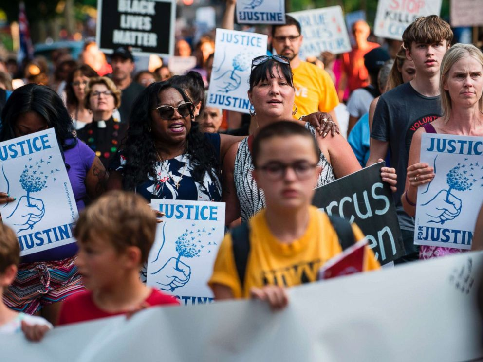PHOTO: Valerie Castile, center, mother of Philando Castile who was killed by a police officer last year, marches in memory of Justine Damond on July 20, 2017 in Minneapolis.