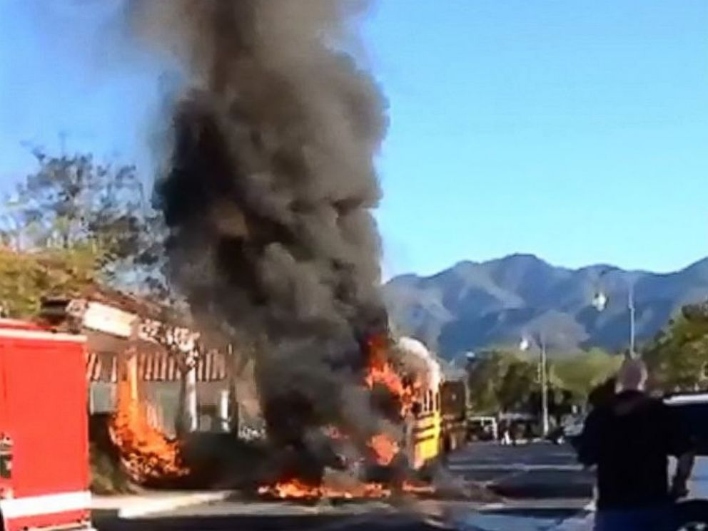 PHOTO: In this still, a school bus that caught fire is pictured outside Rancho Santa Margarita Intermediate School in Rancho Santa Margarita, Calif., March 27, 2015.