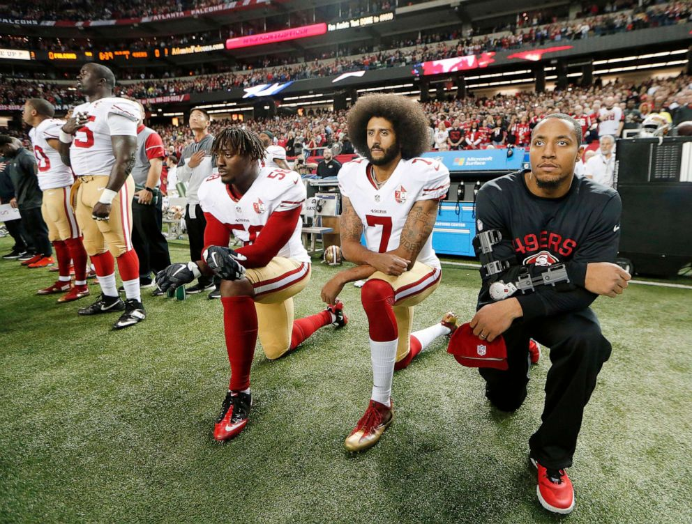 PHOTO: In this Dec. 18, 2016, file photo, San Francisco 49ers quarterback Colin Kaepernick (7) and outside linebacker Eli Harold (58) kneel during the playing of the national anthem before an NFL football game against the Atlanta Falcons in Atlanta.