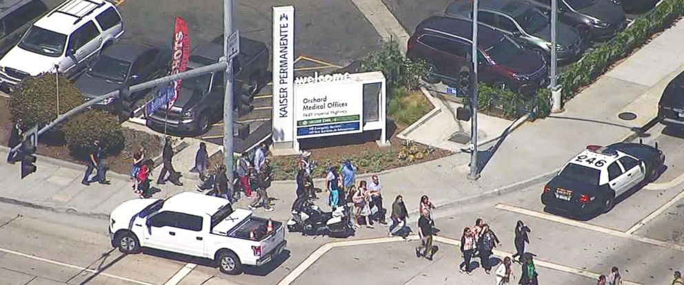 PHOTO: Police activity is seen outside Kaiser Medical Center in Downey, Calif., following reports of an active shooter.