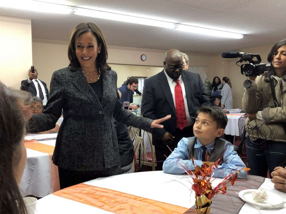 PHOTO: Democratic presidential candidate Sen. Kamala Harris, D-Calif., speaks to Aaron Nachampassak, 11, right and others at a church congregation breakfast in Fort Dodge, Iowa, on Nov. 10, 2019.