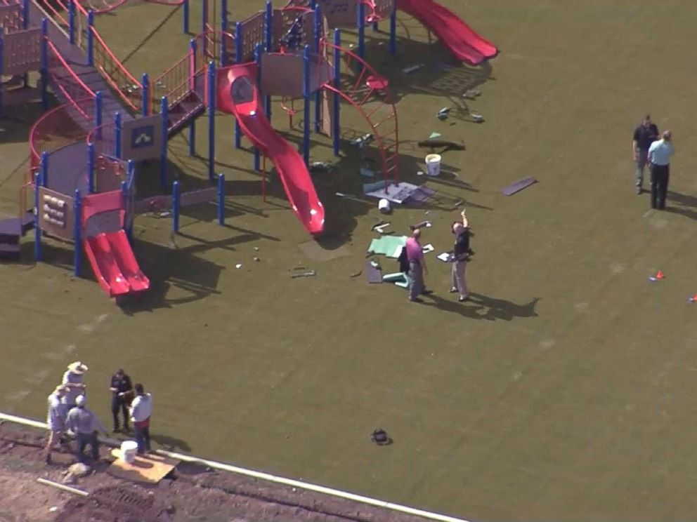 Two workers shot at Kansas elementary school