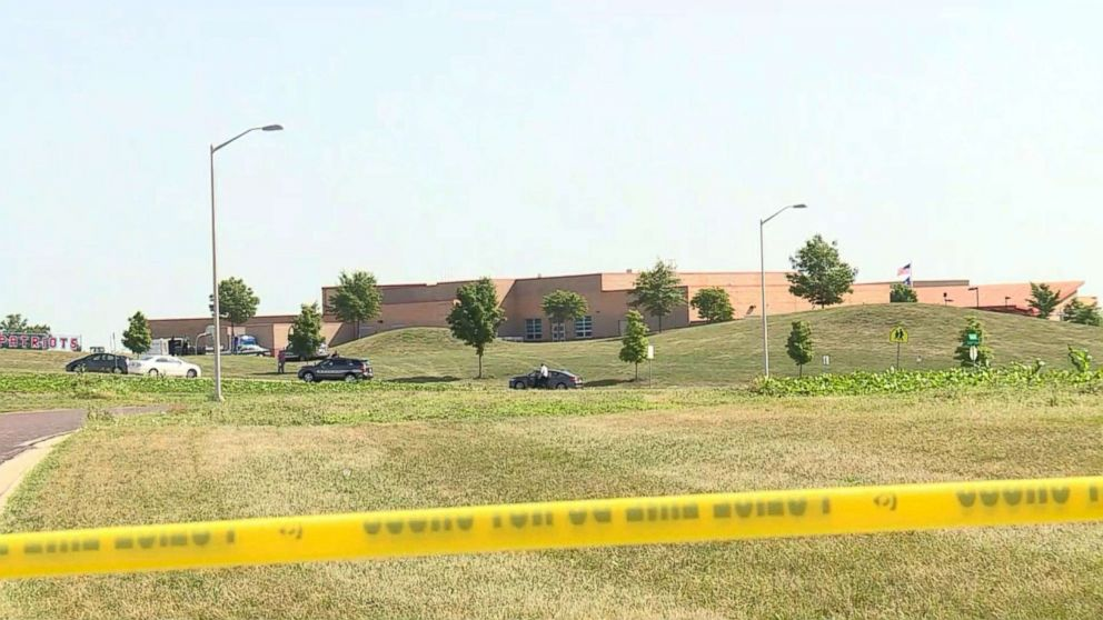 Police tape restricts access to the scene of a reported shooting in Overland Park, Kansas, July 3, 2018.