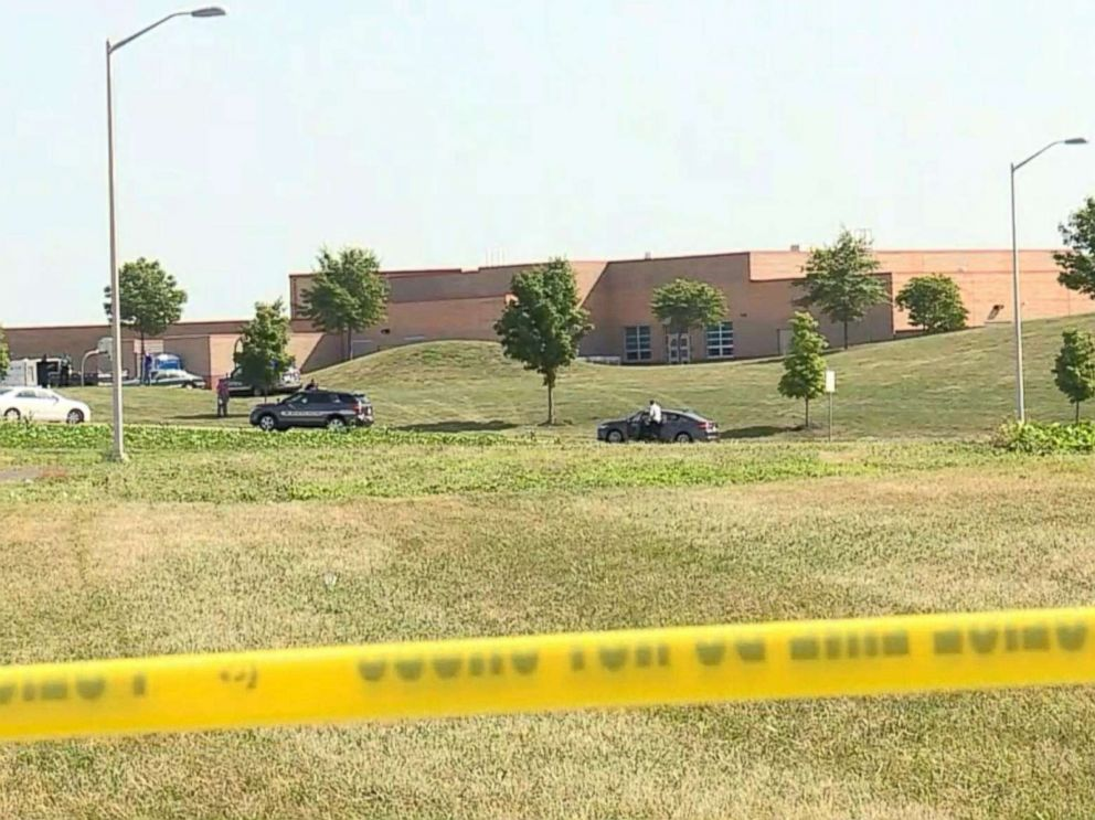 Man arrested in shooting of 2 workers at Kansas elementary school