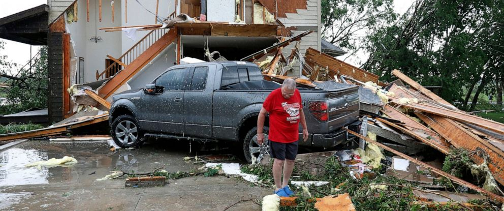 PHOTO: Joe Armison looks over damage to his home after a tornado struck the outskirts of Eudora, Kan., Tuesday, May 28, 2019.